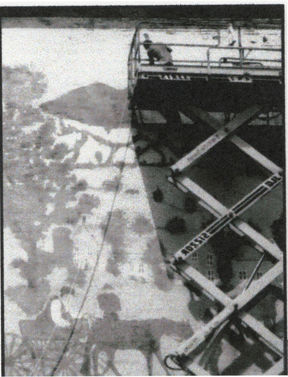 painting from a hydraulic lift